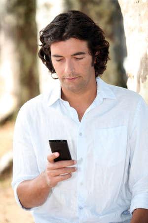 laid back: Texting Stock Photo