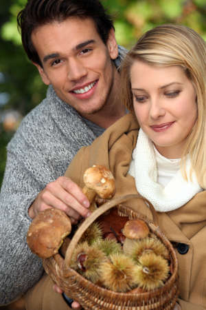 Couple gathering mushrooms Stock Photo - 10854507