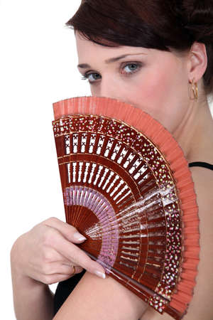 Woman holding a fan Stock Photo - 10854193