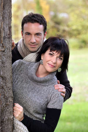 Couple walking in a park Stock Photo - 10854281