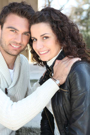 Young man and young woman smiling outdoors photo