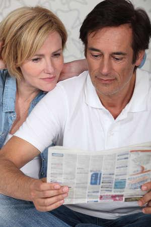 couple reading paper Stock Photo - 10854317