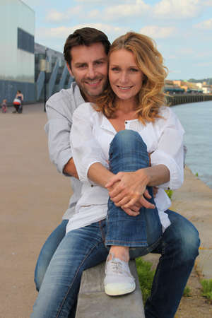 Couple by the waterside Stock Photo - 10854321