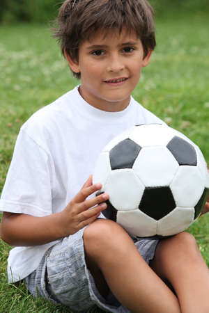 Little boy holding football Stock Photo - 10854271