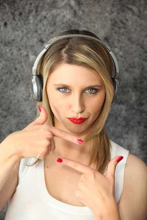 Woman listening to music on headphones Stock Photo - 10854506