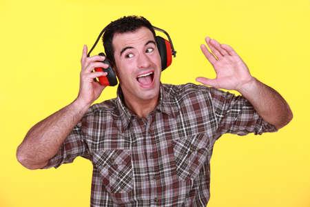 Man wearing earmuffs photo