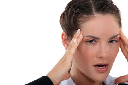 choleric: angry woman having a headache Stock Photo