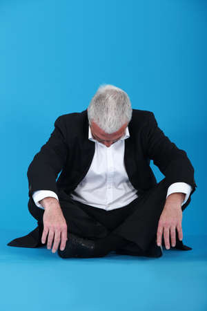 snooze: Grey-haired businessman taking nap Stock Photo