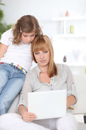 Mother and daughter with laptop Stock Photo - 10854596