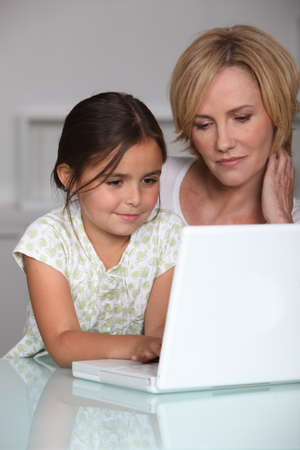 mother and daughter with computer Stock Photo - 10852515