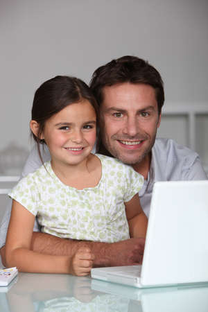 Father and daughter on laptop Stock Photo - 10852531