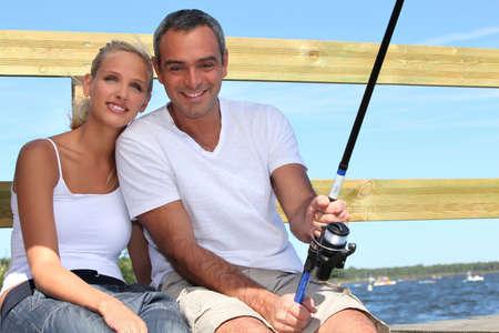 couple doing sea fishing photo