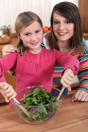 mother and daughter making a salad Stock Photo - 10854576