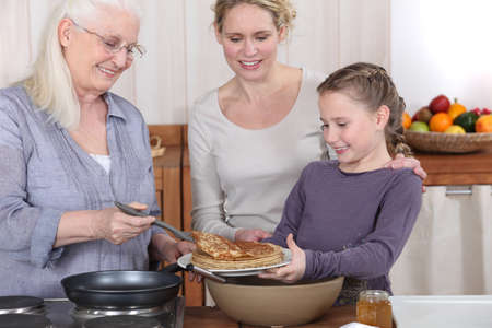 Family eating pancakes Stock Photo - 10854761