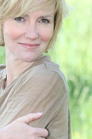 bracing: mature blonde lady