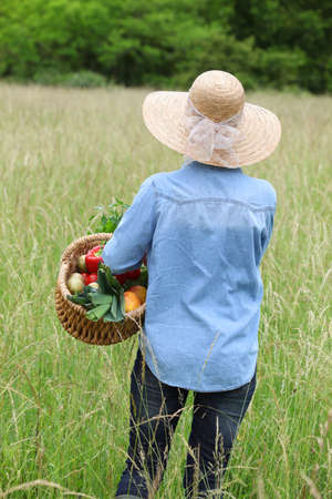 woman with vegetable basket photo