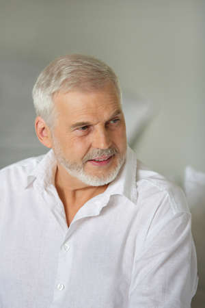 Grey-haired man giving advise
