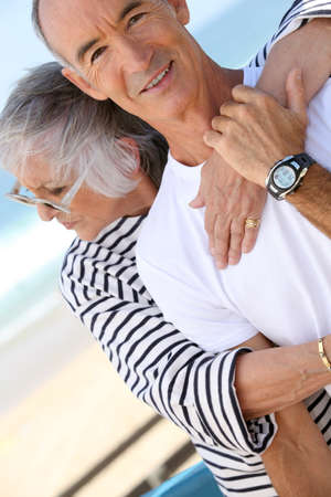 Middle-aged couple hugging at the beach Stock Photo - 10854316