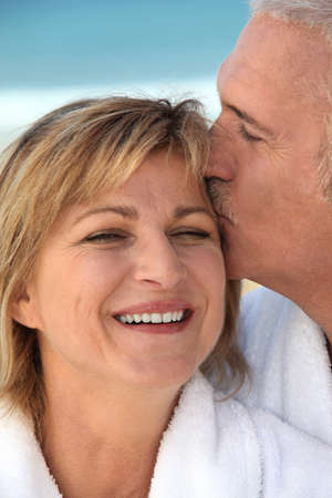 50 55: Husband kissing his wife Stock Photo