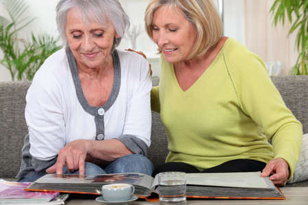 older women: Older women looking at a photo album