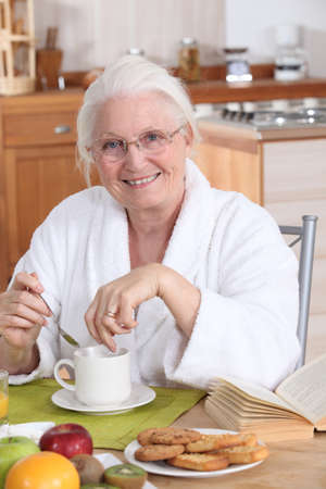 granny in the kitchen having breakfast Stock Photo - 10853399