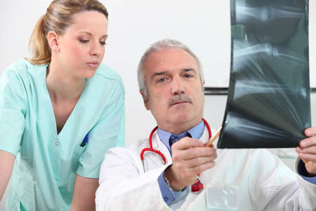 Radiologist and his assistant Stock Photo - 10854994