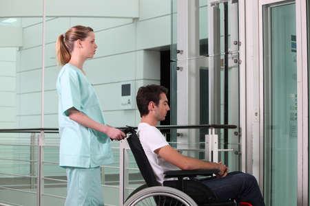 entranceway: Nurse helping man in wheelchair
