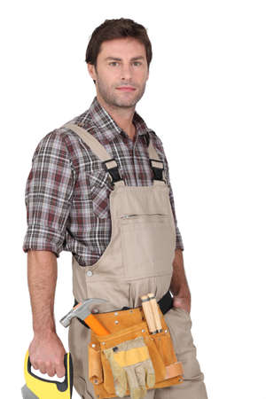 Builder with saw. photo
