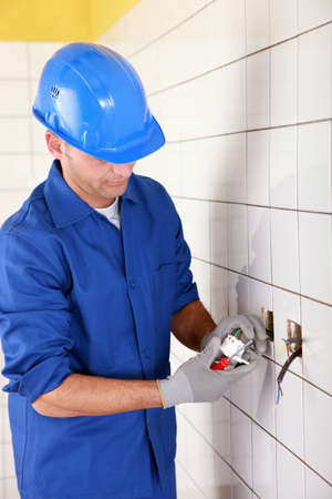 electrician connecting an electrical outlet photo