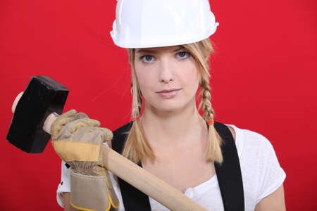 woodworking: Girl holding mallet
