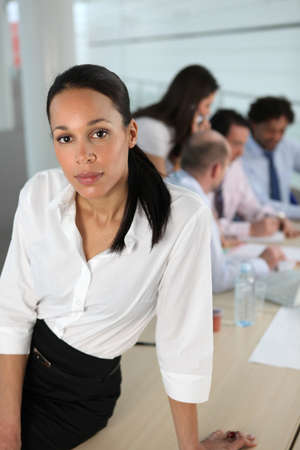 Businesswoman in front of a busy team Stock Photo - 10855290