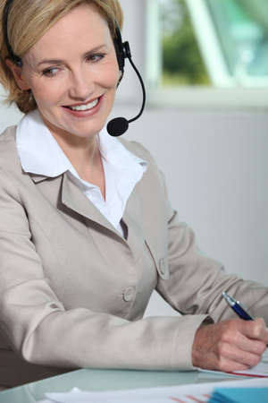 front office: Woman smiling with headset.