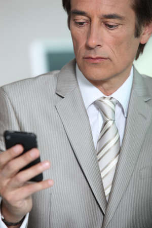 Businessman looking at phone Stock Photo - 10855240