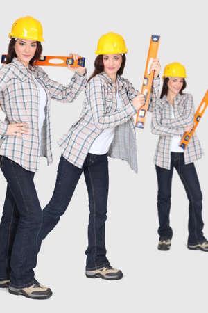craftswoman: craftswoman holding a level