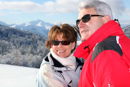 50 to 55 years old: Mature couple on a skiing holiday Stock Photo