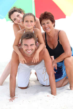 portrait of a family on the beach Stock Photo - 10855305