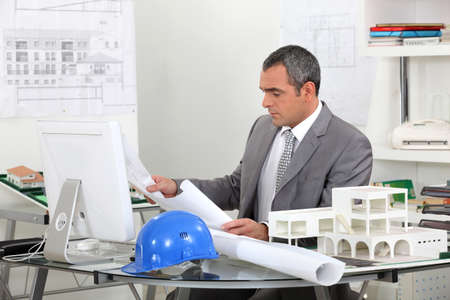 construction management project: Architect looking at plans