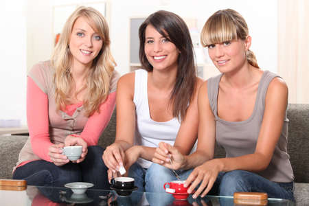 portrait of three women at teatime Stock Photo - 10855394
