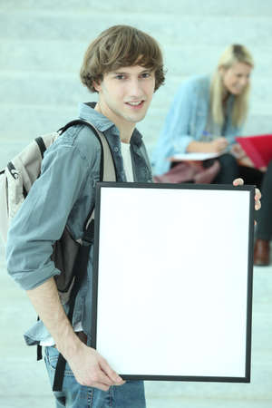 sixth form: Student holding white board