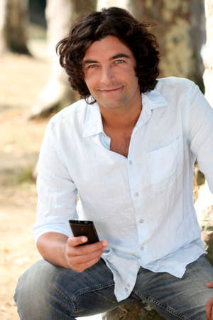 Man looking at his mobile phone Stock Photo - 10855285
