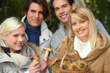 two couples gathering mushrooms Stock Photo - 10855337