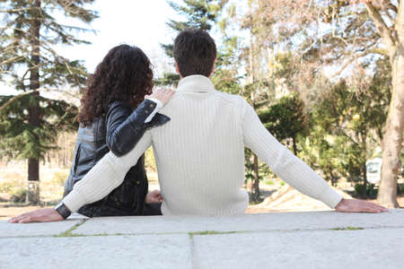woman back view: Couple in love sitting