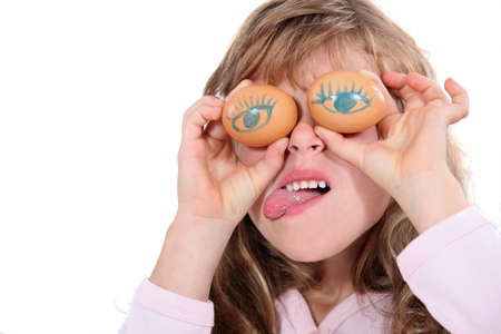antics: Young girl making a funny face Stock Photo