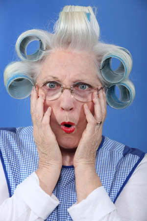 curlers: blue-eyed granny with giant hair curlers