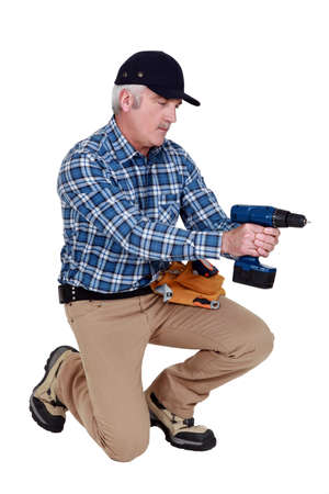 grey haired: Grey haired man with drill