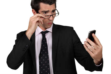 businessman looking at his cell photo