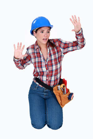 ordeal: Tradeswoman stuck behind an invisible wall Stock Photo