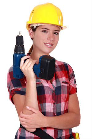 Tradeswoman holding a battery-powered power tool photo