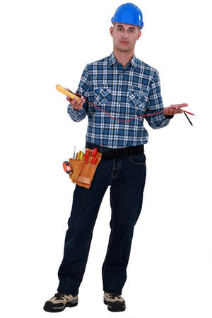 voltmeter: An electrician with a voltmeter. Stock Photo