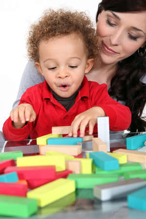 Woman with child and  blocks Stock Photo